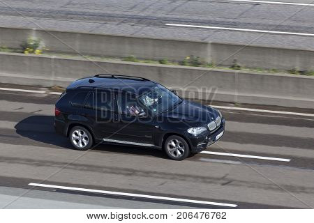 Frankfurt Germany - Sep 19 2017: Black BMW X3 luxury crossover SUV driving on the highway in Germany