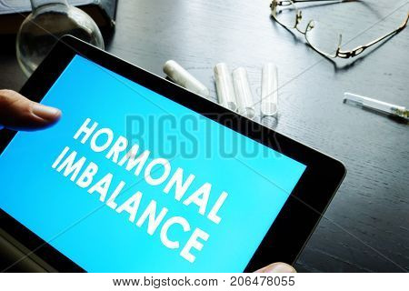 Hormonal imbalance sign on a tablet. Medical concept.