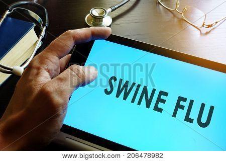 Swine Flu (Swine Influenza A (H1N1 and H3N2)) written in a tablet.