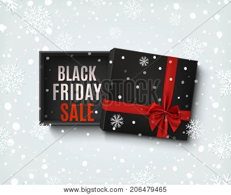 Black Friday sale design. Opened black empty gift box with red ribbon and bow on winter  background with snow and snowflakes. Top view. Template for, banner, brochure or poster. Vector illustration.