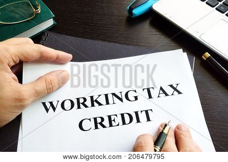 Papers with working tax credit on a table.