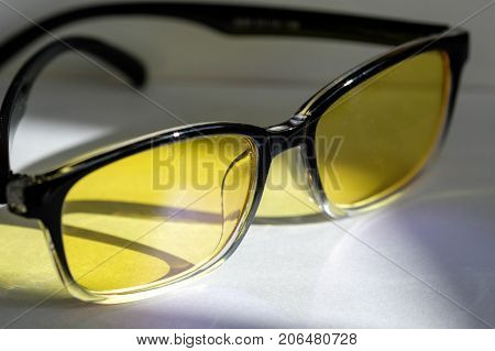 glasses with yellow lenses protection monitors, glasses and reflected light from them