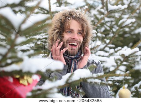 Happy Man Wearing Fur Hood And Scarf On Winter Day
