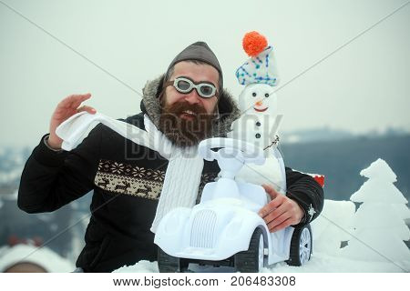Happy Hipster In Pilot Hat And Glasses Showing Scarf