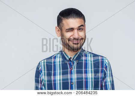 Emotional Hipster Man Wink And Smiling At Camera. Good Humans Emotions And Feelings.