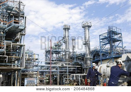 refinery workers with machinery inside large oil and gas industry