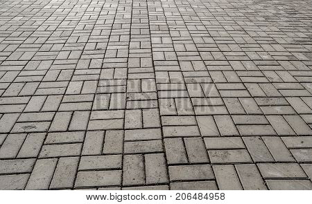 Pavement. Sidewalk tile background. Pavement tile. Top view. Closeup. Footpath. Perspective