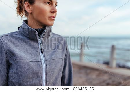 Young Woman Relaxing After Exercise Outdoors