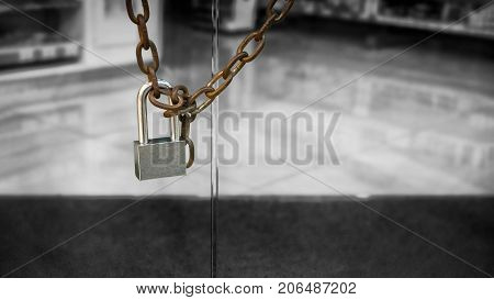Single Padlock around a Chain on a Glass Door