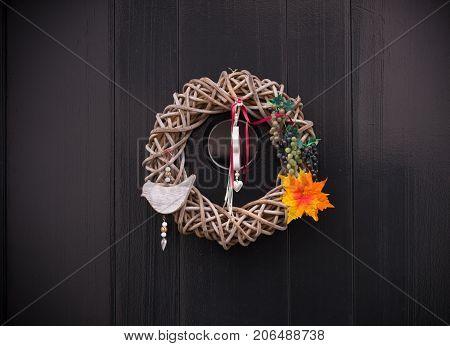 creative door decoration on a dark wooden door