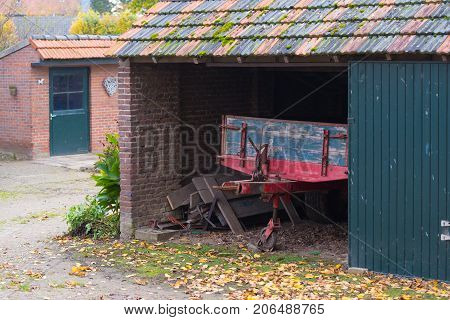 barn with agricultural vehicle in a small village