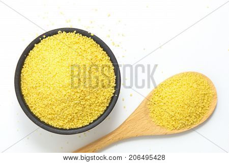 Food concept Raw organic couscous in bowl on white background with copy space