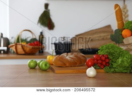 Kitchen interiors. Many vegetables and other meal are ready for been cooked soon.