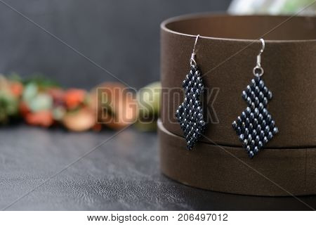 Black Beaded Earrings Hematite Color On A Dark Background