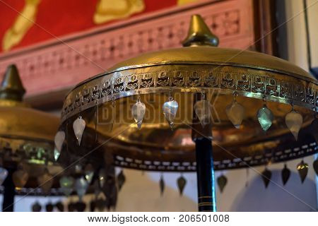 Vintage golden metal chatra at temple of Buddha's Tooth Relic. It is an auspicious symbol in Hinduism and Buddhism.