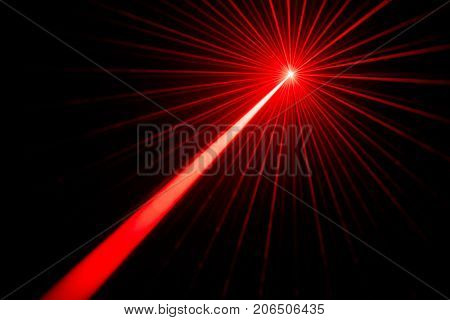 Red laser beams light effect on black background photo.