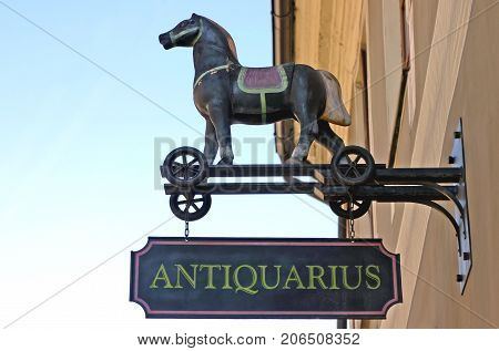 Antique shop exterior sign detail with copy space on the left