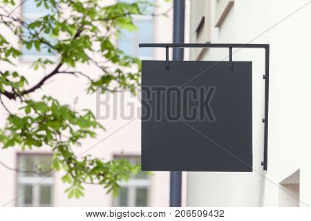 Black empty outdoor signage mockup to add company logo