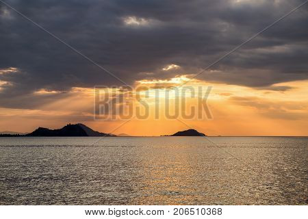 Scenic View Of Dramatic Sky During Sunset over the sea in Flores island Labuan Bajo Indonesia