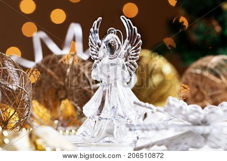 Christmas angel. Crystal Angel on the background of Christmas gold balls. new Year decoration. Christmas ornaments christmas decoration
