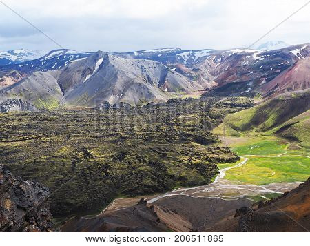 Colored mountains, lava fields and thermal springs in the Landmannalaugar valley, Iceland