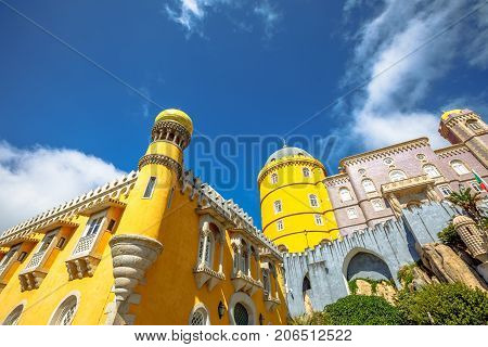 Architecture background. Pena National Palace, one of seven wonders of Portugal and Unesco Heritage Site. Pena Castle is a popular landmark. Municipality of Sintra near Lisbon. Sunny day, blue sky.