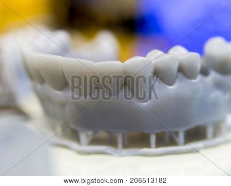 The lower jaw man, created on a 3d printer from a photopolymer material. Stereolithography 3D printer, technology of liquid photopolymerization under UV light. Modern additive and medical technologies