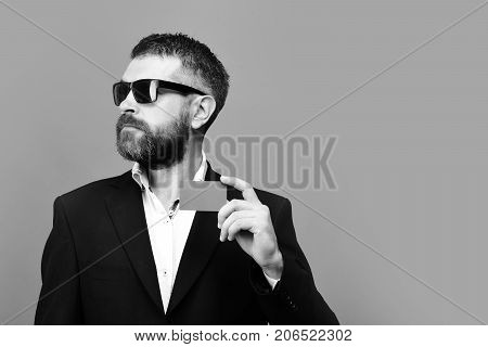 Businessman With Empty Card, Copy Space. Man With Beard