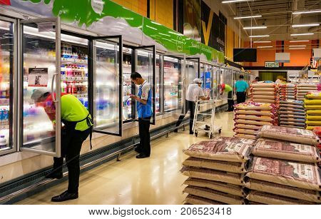 BANGKOK THAILAND - JULY 28: A number of unidentified employees check store inventories while being supervised by the manager in BigC Extra Supermarket on July 28 2017 in Bangkok.