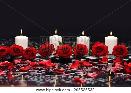 Beautiful red rose, petals, with white candle and therapy stones
