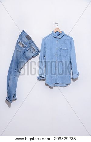 Blue jeans , blue shirt on hanging isolated