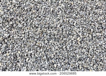 Ground stone grey background of many small stones