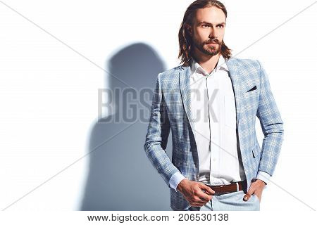portrait of handsome fashion stylish hipster businessman model dressed in elegant light blue suit isolated on white