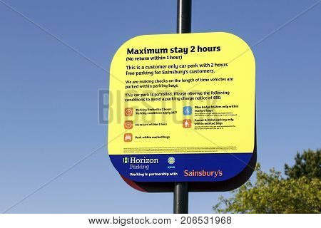 Swansea, UK: June 2017: Sainsburys Car Parking Sign stating the terms and conditions of use and how much the fine is if over staying the two hour maximum limit. Horizon Parking are able to fine overstayers £60.