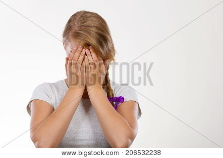 Shy Teenage Girl Hiding Face Behind Hand