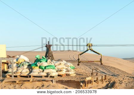 A cableway pylon and trolley at the guano island near Longbeach in the Namib Desert on the Atlantic Coast of Namibia