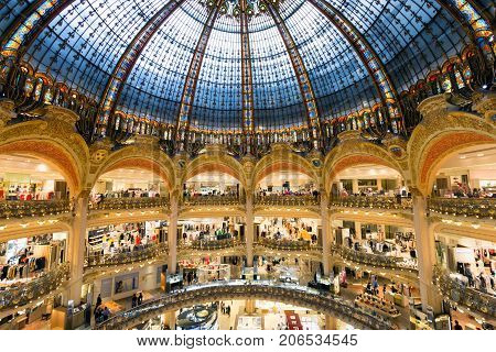 PARIS FRANCE - JUNE 18 2015: Interior of the Galeries Lafayette in Paris. The architect Georges Chedanne designed the store where a Art Nouveau glass and steel dome was finished in 1912