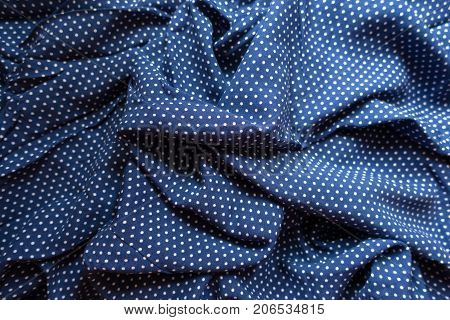 Rumpled Fabric In Blue And White With Polka Dot Print