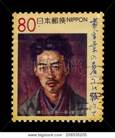JAPAN - CIRCA 1999: A stamp printed in Japan shows painted by Fujii Tokio portrait of Sato Ichiei, was a  japanese poet and writer, circa 1999