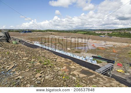 Swansea, UK: May 22, 2016: Ground being prepared for the construction of a housing estate on reclaimed land.