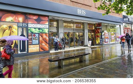 Swansea, UK: June 19, 2016: Shoppers enter a department store that is closing down. British Home Stores is a British department store chain.