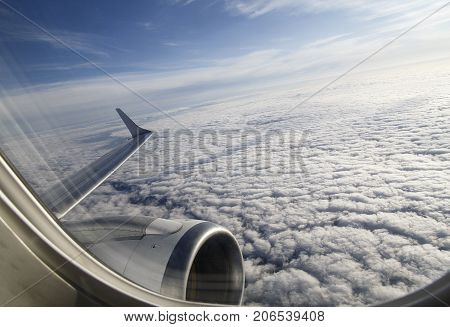 View from an airplane window soon after take off while accelerating and changing course.