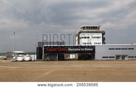 Cardiff, UK: May 29, 2016: View of the control tower taken from the airplane while taxing down the runway. Cardiff Airport has been under the ownership of the Welsh Government since March 2013