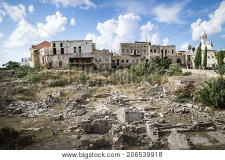 Centre of Tyre with ruins and mosque with blue sky, Tyre, Sour, Lebanon