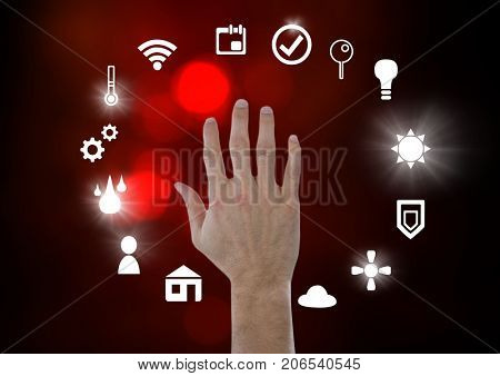 Digital composite of Hand touching icons interface of internet of things