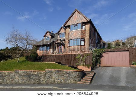 Swansea, UK: March 11, 2016: A luxury detached house in an upmarket housing estate. Prices of large detached houses in prime locations have escalated enormously in the last decade.