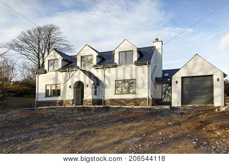 Swansea, UK: January 02, 2015: An individually designed detached, luxury property near completion. Self build is possibly the most inexpensive way to attain a large detached home in the suburbs.