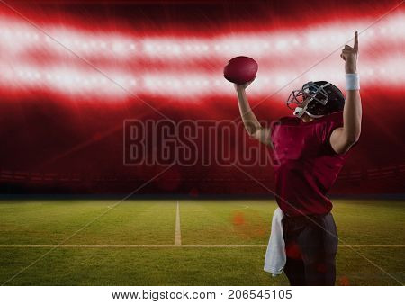 Digital composite of american football  player cheering in stadium