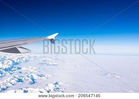 High Altitude Over Alps Icy View From Plane Window