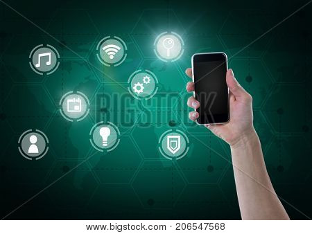 Digital composite of Hand holding phone with icons interface of internet of things